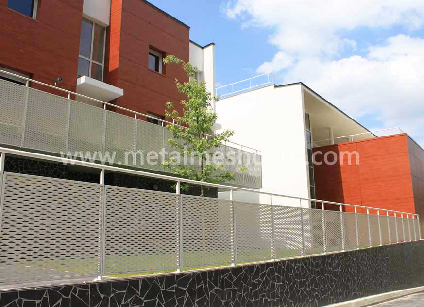 Exhibition Hall With Perforated Metal Balustrade